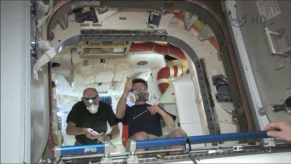 Yay! - astronauts inside the Dragon spacecraft. (NASA / May 26, 2012)